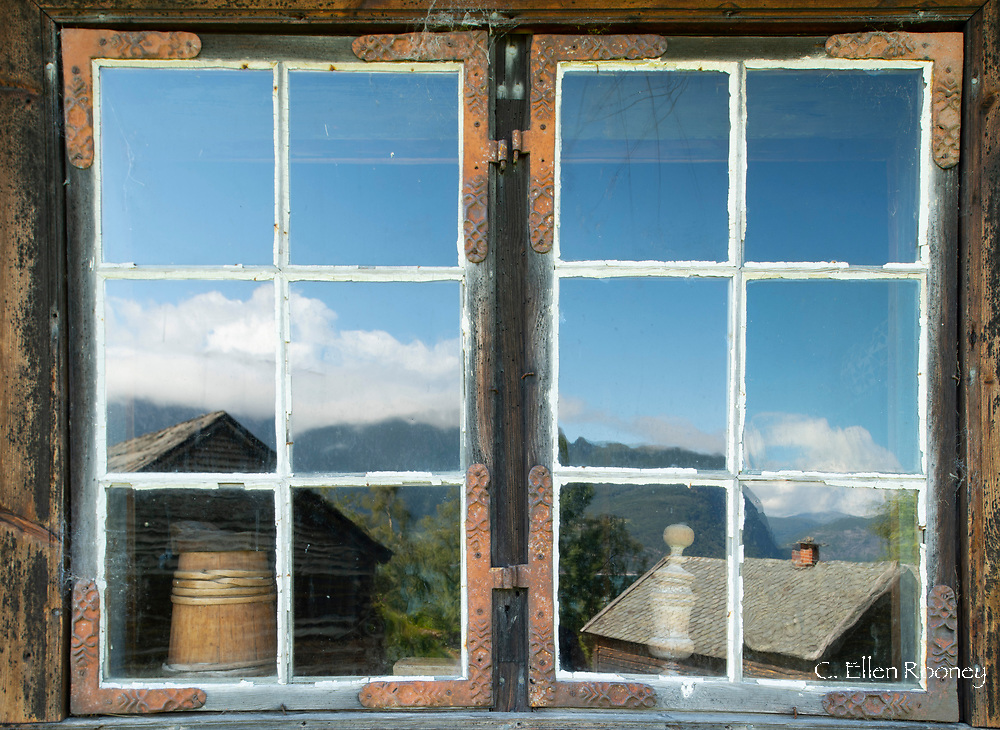 Reflections in an old window at the Hardanger Folk Museum in Utne, Vestlandet, Norway