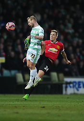 Manchester United's Darren Fletcher battles for the high ball with Yeovil Town's Simon Gillett  - Photo mandatory by-line: Joe meredith/JMP - Mobile: 07966 386802 - 04/01/2015 - SPORT - football - Yeovil - Huish Park - Yeovil Town v Manchester United - FA Cup - Third Round