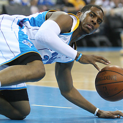 18 February 2009: New Orleans Hornets guard Chris Paul (3) gets control of the ball after a fall during a NBA basketball game between the Orlando Magic and the New Orleans Hornets at the New Orleans Arena in New Orleans, Louisiana.