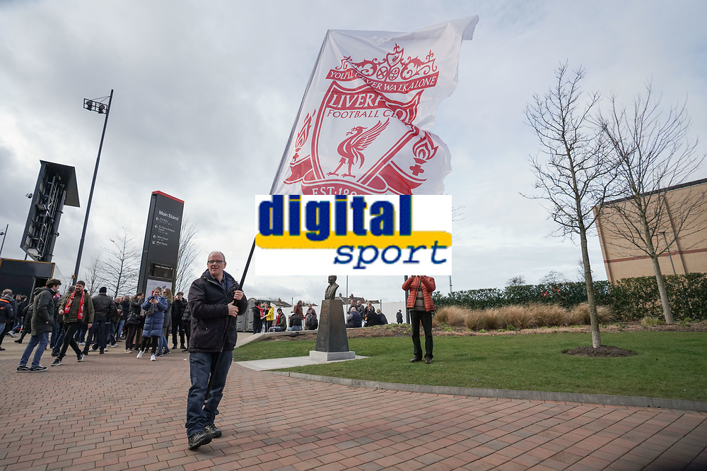 Football - 2019 / 2020 Premier League - Liverpool vs. AFC Bournemouth<br /> <br /> A man waves a Liverpool flag outside Anfield, home of Liverpool, at Anfield.<br /> <br /> <br /> COLORSPORT/TERRY DONNELLY
