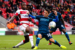 Tom Nichols of Bristol Rovers takes on Donervon Daniels of Doncaster Rovers - Mandatory by-line: Robbie Stephenson/JMP - 19/10/2019 - FOOTBALL - The Keepmoat Stadium - Doncaster, England - Doncaster Rovers v Bristol Rovers - Sky Bet League One