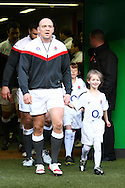 Mike Tindall of England leads his team onto the pitch before the RBS Six Nations match between England and Italy at Twickenham, London, UK on 12th February 2011 (Photo by Andrew Tobin www.slikimages.com)