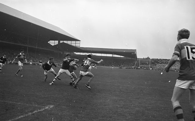 Kerry's McKinney watches anxiously as he sees his Capt. T. Hanlon blocked by Westmeath defender, Malone during the All Ireland Minor Gaelic Football Final Kerry v. Westmeath in Croke Park on the 22nd September 1963.
