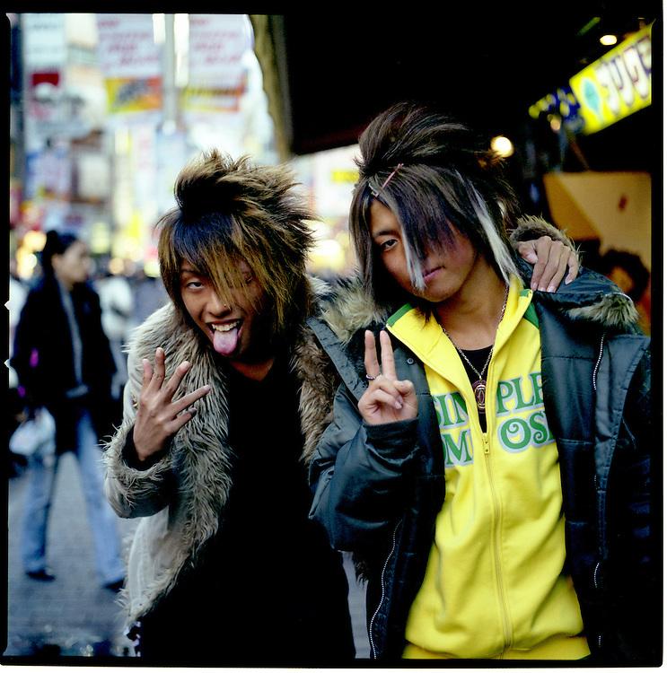 Gal-O boys imitate gang handsignals which have no significance in Japan., Shibuya, Tokyo.