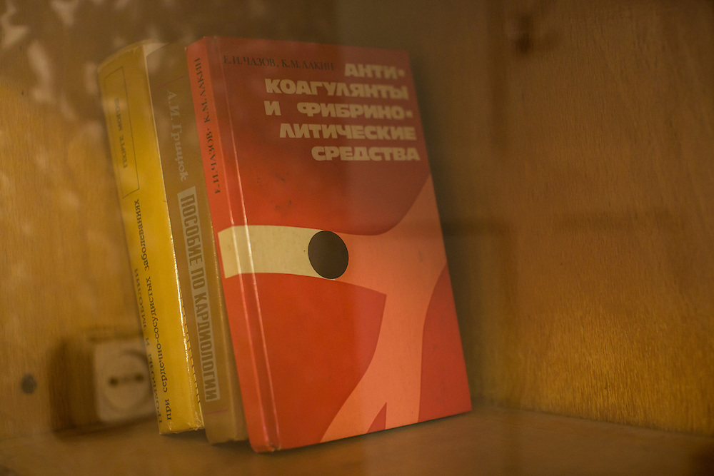 ZIMOGORYE, UKRAINE - MARCH 15, 2015: Medical texts on a shelf at the Zimogoryivskaya Ambulatory in Zimogorye, Ukraine. CREDIT: Brendan Hoffman for The New York Times