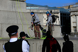 UK ENGLAND LONDON 18APR16 - Greenpeace activists get arrested after climbing Nelson's Column at 4am to demand action on air pollution. Alison Garrigan (29) and Luke Jones (30) fit the statue of Admiral Lord Nelson, towering 52 metres above Trafalgar Square, with an emergency face mask. <br /> <br /> <br /> <br /> jre/Photo by Jiri Rezac<br /> <br /> / Greenpeace<br /> <br /> © Jiri Rezac 2016