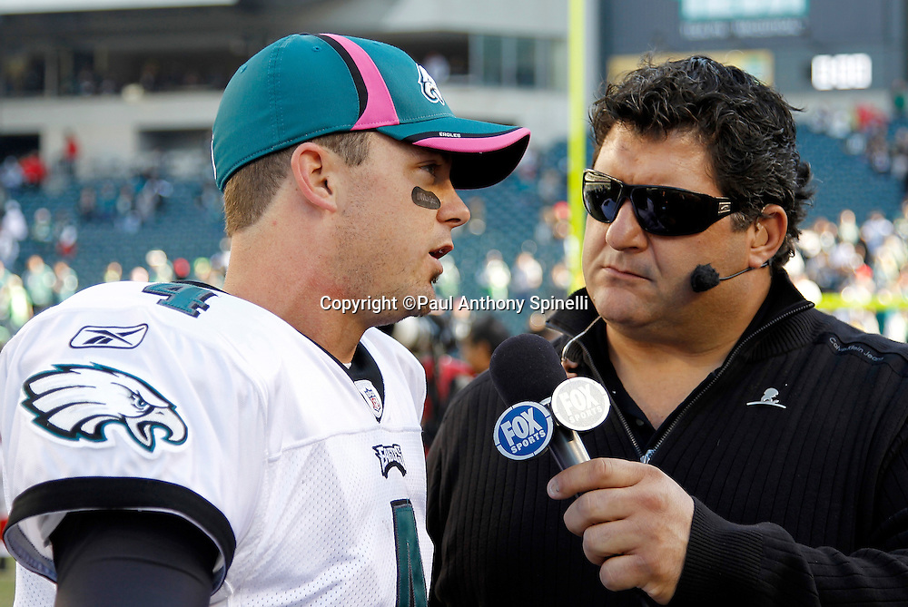 Philadelphia Eagles quarterback Kevin Kolb (4) does a postgame interview with FOX Sports sideline reporter Tony Siragusa after the NFL week 6 football game against the Atlanta Falcons on Sunday, October 17, 2010 in Philadelphia, Pennsylvania. The Eagles won the game 31-17. (©Paul Anthony Spinelli)