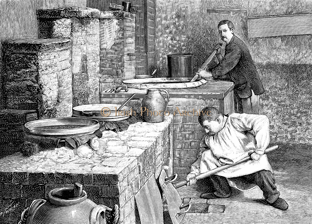 A stage in the separation of radium from pitchblende using sodium carbonate. Curies' laboratory, Paris c1900. Engraving