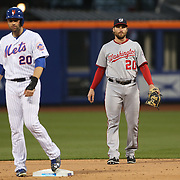 NEW YORK, NEW YORK - May 18:  Neil Walker #20, (left), of the New York Mets on second base next to Daniel Murphy #20 of the Washington Nationals, playing second base during the Washington Nationals Vs New York Mets regular season MLB game at Citi Field on May 18 2016 in New York City. (Photo by Tim Clayton/Corbis via Getty Images)