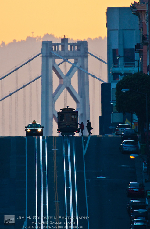 Morning commuters board a cable car at sunrise - San Francisco, California