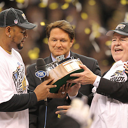 Jan 24, 2010; New Orleans, LA, USA; Former New Orleans Saints running back Deuce McAllister hands the NFC Championship trophy to owner Tom Benson following an overtime victory over the Minnesota Vikings in the 2010 NFC Championship game at the Louisiana Superdome. Mandatory Credit: Derick E. Hingle-US PRESSWIRE