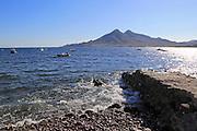 View out to sea and Los Frailes volcanoes from, Isleta de Moro village, Cabo de Gata natural park, Nijar, Almeria, Spain