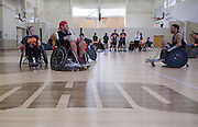 Paul Mann, left, and other athletes participate in the the 8th Annual FourPlay! Quad Rugby Tournament in the Ping Recreation Center on Oct. 4, 2014. Photo by Lauren Pond