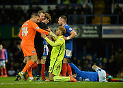 Hartlepool United Striker Mikael Mandron with a heavy challenge on Portsmouth defender Christian Burgess during the Sky Bet League 2 match between Portsmouth and Hartlepool United at Fratton Park, Portsmouth, England on 12 December 2015. Photo by Adam Rivers.