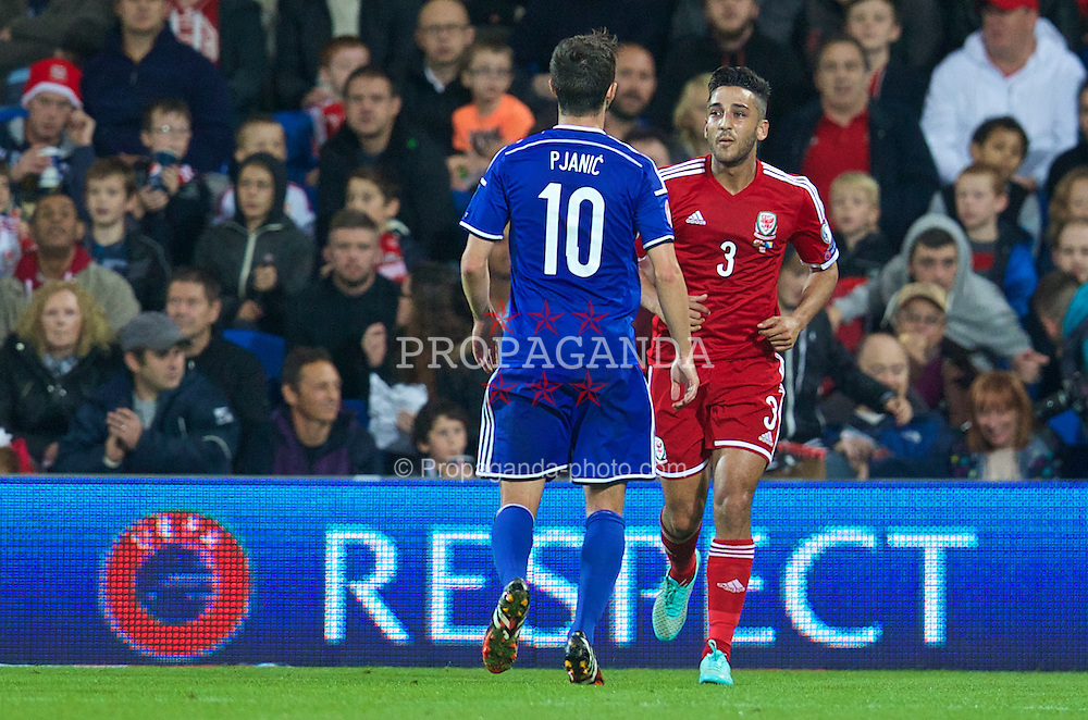CARDIFF, WALES - Friday, October 10, 2014: Wales' Neil Taylor and Bosnia and Herzegovina's Miralem Pjanic during the UEFA Euro 2016 qualifying match at the Cardiff City Stadium. (Pic by David Rawcliffe/Propaganda)