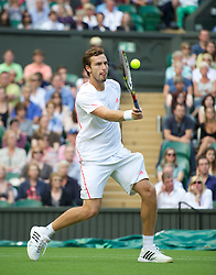 LONDON, ENGLAND - Monday, June 25, 2012: Ernests Gulbis (LAT) during the Gentleman's Singles 1st Round match on the opening day of the Wimbledon Lawn Tennis Championships at the All England Lawn Tennis and Croquet Club. (Pic by David Rawcliffe/Propaganda)