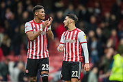 Julian Jeanvier (Brentford) & Said Benrahma (Brentford) thanking Brentford FC supporters following the EFL Sky Bet Championship match between Brentford and Derby County at Griffin Park, London, England on 6 April 2019.