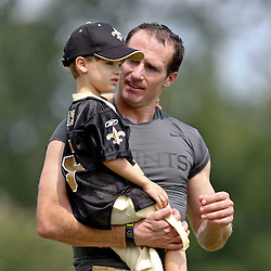 Aug 3, 2013; Metairie, LA, USA; New Orleans Saints quarterback Drew Brees (9) with son Baylen Brees following a scrimmage at the team training facility. Mandatory Credit: Derick E. Hingle-USA TODAY Sports