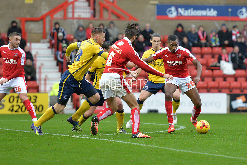Swindon Town striker Jonathan Obika on the attack at the edge of the box during the Sky Bet League 1 match between Swindon Town and Scunthorpe United at the County Ground, Swindon, England on 14 November 2015. Photo by Mark Davies.