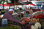 A Palestinian man shops for produce August 06, 2007 in the main market in Gaza City, Gaza. Political pressure on Hamas has been implemented through the closure of the crossings into Israel since the group took control in June, and as a result Gaza's economy has taken a turn for the worse. Prices on numerous consumer goods have as much as doubled recently, and much of the strip remains dependent on foreign aid.