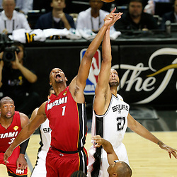 Jun 11, 2013; San Antonio, TX, USA; Miami Heat center Chris Bosh (1) and San Antonio Spurs power forward Tim Duncan (21) tip off to start game three of the 2013 NBA Finals at the AT&T Center. Mandatory Credit: Derick E. Hingle-USA TODAY Sports