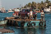 New Cars imported from the mainland<br /> Puerto Ayora, Santa Cruz Island, GALAPAGOS ISLANDS<br /> ECUADOR.  South America