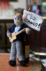© Licensed to London News Pictures. 26/10/2012..Saltburn, Cleveland, England..Knitted James Arthur figure in the Victoria Pub in Saltburn...The Saltburn 'Yarnbombers' have struck again in the Cleveland seaside town of Saltburn by the Sea. This time, their target is the X Factor star James Arthur who comes from the Saltburn.. Two locations within the town each received an anonymous package in the post containing a knitted representation of the singer..The Rapps cafe and the Victoria pub each received a figure because of the huge support they offer the singer...An X Factor pizza menu is available at Rapps offering such delights as Nicole Chef-Zinger whilst the Victoria Pub screens each show live to a packed bar...Photo credit : Ian Forsyth/LNP
