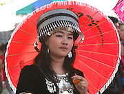 A sixteen-year-old Hmong girl shows off her traditional costume during Hmong New Year's celebration in the town of Lak 52 north of Vientiane, Laos.
