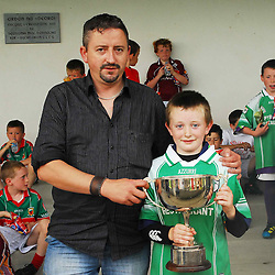 Brian O'Halloran recieves the cup from Joe Mulroe (sponsor Paddy's Bar) as captain of the Neale U10's which won the footbal competition that was part of the Tourmakeady Agricultural Show...Pic Conor McKeown