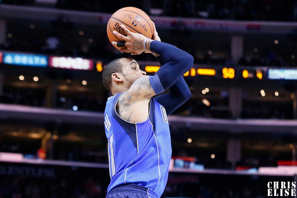 10 January 2014: Dallas Mavericks guard Monta Ellis (11) takes a jump shot during the Los Angeles Clippers 120-100 victory over the Dallas Mavericks, at the Staples Center, Los Angeles, California, USA.