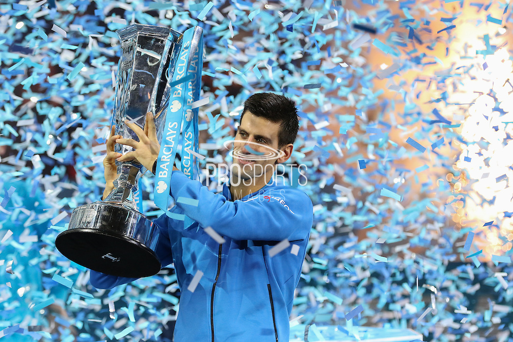Novak Djokovic lifts the winning trophy during the final of the ATP World Tour Finals between Roger Federer of Switzerland and Novak Djokovic at the O2 Arena, London, United Kingdom on 22 November 2015. Photo by Phil Duncan.