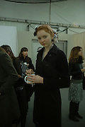 Lily Cole. Backstage before the Chanel couture fashion show. Grand Palais, Ave Winston Churchill. Paris. 24  January  2006.  ONE TIME USE ONLY - DO NOT ARCHIVE  © Copyright Photograph by Dafydd Jones 66 Stockwell Park Rd. London SW9 0DA Tel 020 7733 0108 www.dafjones.com
