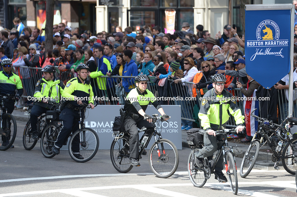 BOSTON, April 21, 2014 Policemen guard along Boylston street where the 2014 Boston marathon is held, in Boston, Massachusetts, the United States, April 21, 2014. Under protection of more than 10,000 police, army forces, and security company staff, the runners participating in the 2014 Boston Marathon completed their race in safety.