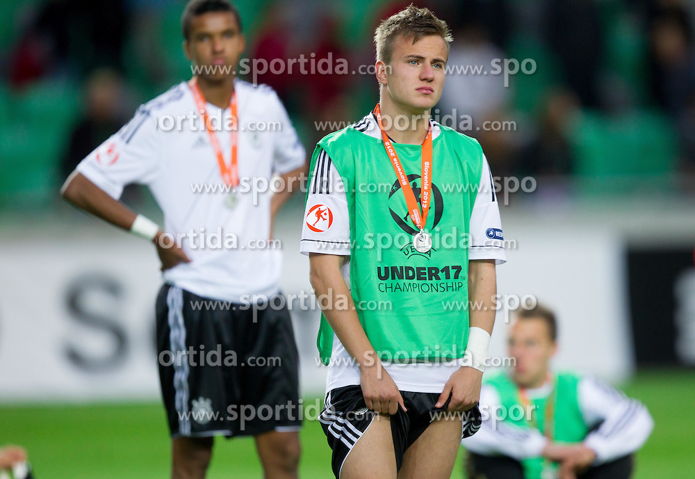 Dissappointed players of Germany after the UEFA European Under-17 Championship Final match between Germany and Netherlands on May 16, 2012 in SRC Stozice, Ljubljana, Slovenia. Netherlands defeated Germany after penalty shots and became European Under-17 Champion 2012. (Photo by Vid Ponikvar / Sportida.com)