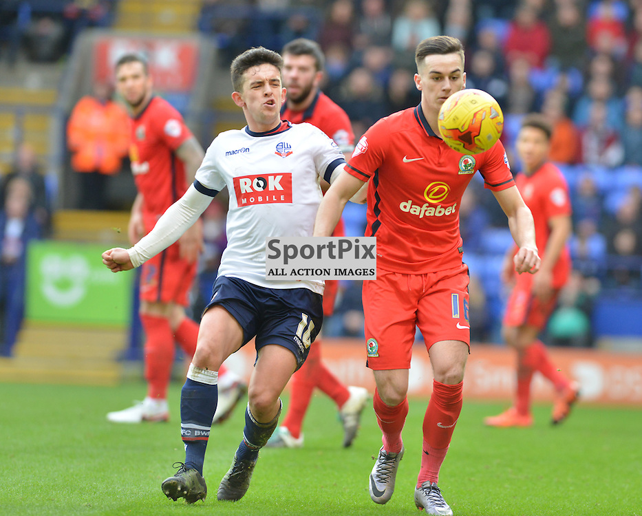 Bolton's Zac Clough clashes with Adam Henley of Rovers......(c) BILLY WHITE | SportPix.org.uk