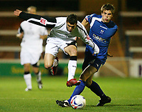 Photo: Rich Eaton.<br /> <br /> Peterborough United v Swansea City. Johnstone's Paint Trophy. 31/10/2006. Chris Jones left of Swansea tries to leap over the tackle of Peterboroughs Shane Huke
