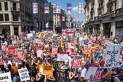 © Licensed to London News Pictures. 13/07/2018. London, UK. Thousands of protesters march along Regent Street in central London as President of the United States of America Donald Trump continues his visit to the United Kingdom. Photo credit: Rob Pinney/LNP