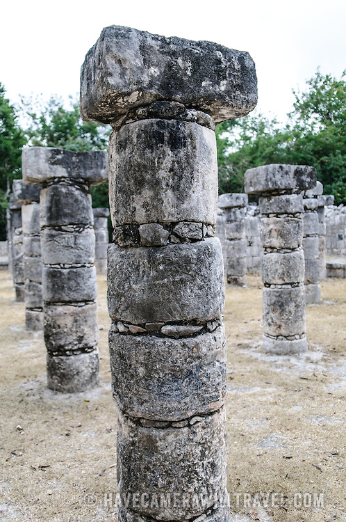 Vertical shot of a column in the Plaza of the Thousand Columns at Chichen Itza Mayan ruins archeological zone in the heart of Mexico's Yucatan Peninsula.