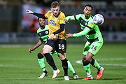 Forest Green Rovers Tahvon Campbell(14) and Cambridge United's George Maris(18) battle for the ball during the EFL Sky Bet League 2 match between Cambridge United and Forest Green Rovers at the Cambs Glass Stadium, Cambridge, England on 2 October 2018.