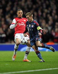 Arsenal's Kieran Gibbs battles for the ball with Bayern Munich's Philipp Lahm - Photo mandatory by-line: Joe Meredith/JMP - Tel: Mobile: 07966 386802 19/02/2014 - SPORT - FOOTBALL - London - Emirates Stadium - Arsenal v Bayern Munich - Champions League - Last 16 - First Leg