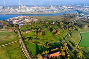 Nederland, Groningen, Delfzijl, 04-11-2018; Weiwerd (Gronings: Waaiwerd), voormalig wierdedorp, de radiale structuur van de wierde (terp) zichtbaar in het landschap. Dorp is grotendeels ontruimd ivm uitbreiding haven Delfzijl (die tot op heden is uitgebleven).<br /> Weiwerd (Gronings: Waaiwerd), former  village, the radial structure of the mound is visible in the landscape. <br /> <br /> luchtfoto (toeslag op standaard tarieven);<br /> aerial photo (additional fee required);<br /> copyright &copy; foto/photo Siebe Swart