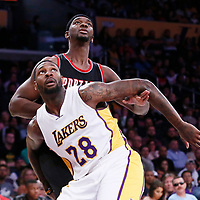 26 March 2016: Los Angeles Lakers center Tarik Black (28) vies for the rebound with Portland Trail Blazers forward Noah Vonleh (21) during the Portland Trail Blazers 97-81 victory over the Los Angeles Lakers, at the Staples Center, Los Angeles, California, USA.