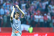 Poland's goalkeeper Wojciech Szczesny thanks to fans for support after the EURO 2016 qualifying match between Poland and Germany on October 11, 2014 at the National stadium in Warsaw, Poland<br />