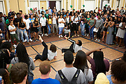Students watch dancers during the fair.