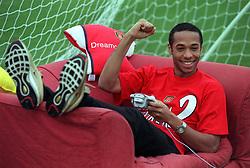 This picture can only be used within the context of an editorial feature. Arsenal soccer star  Henry plays Virtua Striker 2 on the Sega Dreamcast, during a photocall at his training ground in London.    * Virtua Striker 2  is available from Friday January 21, 2000, priced at   39.99.
