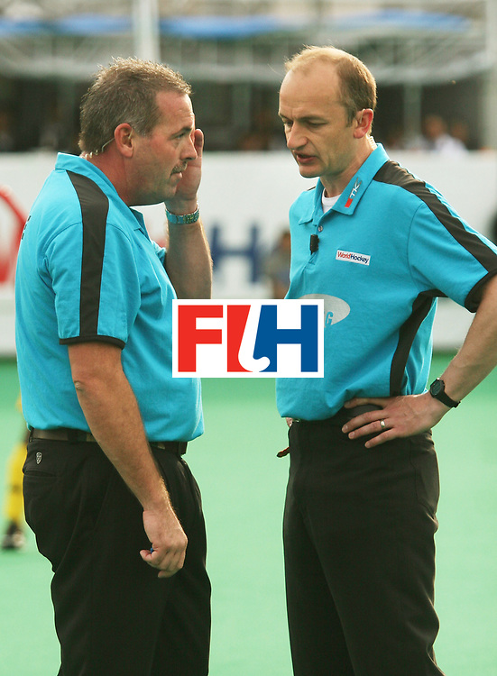 Kakamigahara (Japan): Umpires Grime Murray (left) and Jamson Hamish seen in discussion over the controversial equaliser in the match between Japan and Malaysia at the Olympic Hockey Qualifier at Gifu Perfectural Green Stadium at Kakamigahara on 12 April 2008.  Photo: GNN/ Vino John