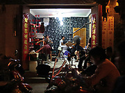 Night-time hair salon on Renmin road, Dali, Yunnan, China; September, 2013.