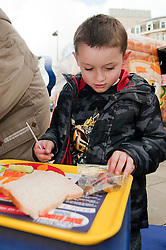The Kingsmill Big Lunch Tour reaches Sheffield and puts the fun back into lunchtimes as Aidan Davies of Winkobank tries his hand at sandwich making on Fargate Sheffield Wednesday...http://www.pauldaviddrabble.co.uk.11 April 2012 .Image © Paul David Drabble