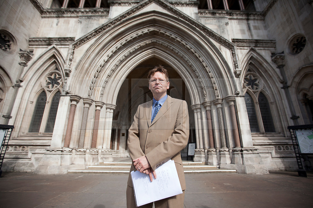© Licensed to London News Pictures. 04/09/2012. LONDON, UK. John Halford, a solicitor representing relatives of the victims of the 'Batang Kali Massacre' stands outside the Royal Courts of Justice in London today (04/09/12) after a judicial review ruled that there is no legal obligation for the UK government to hold a public enquiry into the 1948 killings. The massacre took place during the Communist insurgency in post WW2 Malaya and saw 24 civilians of Batang Kali village killed by a patrol of the 2nd Battalion the Scots Guards.  Photo credit: Matt Cetti-Roberts/LNP