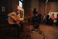 """Patrick McClary plays guitar during the Yoknapatawpha Arts Council's """"Art For Everyone"""" fundraiser in Oxford, Miss. on Tuesday, October 18, 2011."""